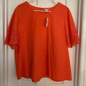 Coral/orange short sleeve blouse; eyelet sleeves